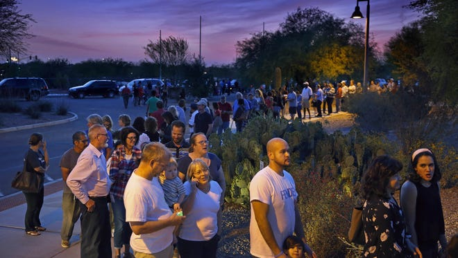 People wait in line to vote at 7:00pm in the Arizona Presidential Primary Election at the Enviromental Education Center Tuesday, March 22,  2016  in Chandler, Ariz. Those in line at the 7:00pm cut off were still allowed to vote.