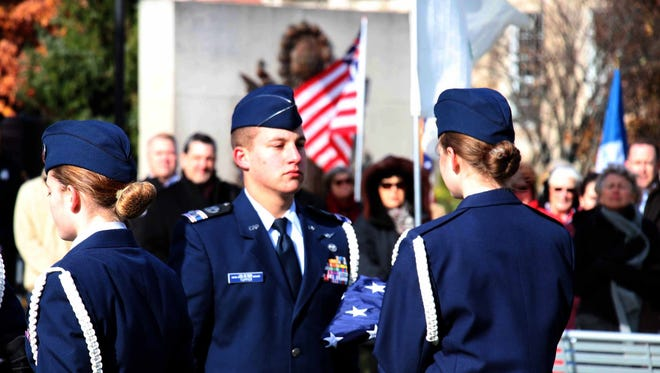 Civil Air Patrol Member Nicholas Tupper (Bloomfield Hills) of the Oakland Composite Squadron presenting the flag.