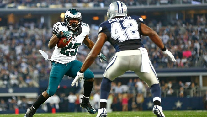 Philadelphia Eagles running back LeSean McCoy (25) is met by Dallas Cowboys strong safety Barry Church (42) just short of the goal line during the first half on Thursday, Nov. 27, 2014, at AT&T Stadium in Arlington, Texas. (Ron Jenkins/Fort Worth Star-Telegram/TNS)