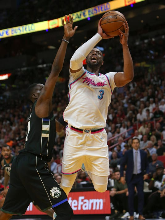 Milwaukee at Miami. The Heat s Dwyane Wade goes to the basket against the  Bucks  ... 39fee3985