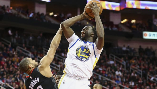 Draymond Green shoots over Rockets guard Eric Gordon during a game in January.