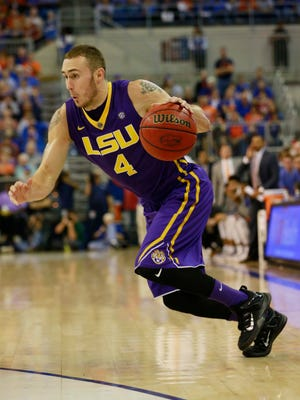 LSU Tigers guard Keith Hornsby (4) drives to the basket against the Florida Gators during the second half at Stephen C. O'Connell Center. Florida Gators defeated the LSU Tigers 68-62.