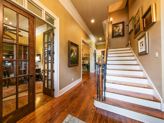 The entrance of the home includes this grand staircase.