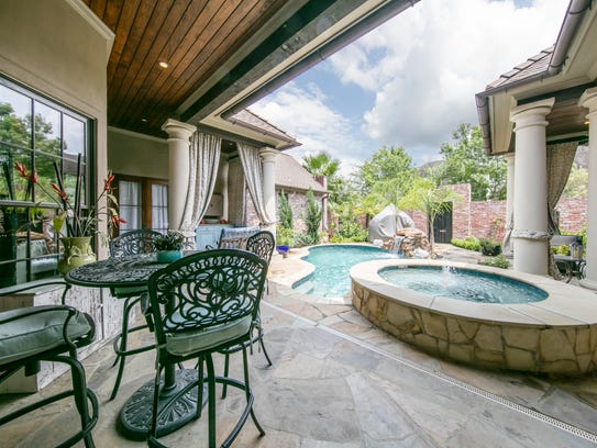 The outdoor patio overlooks the pool area.