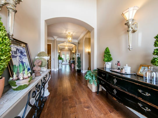 An elegant foyer graces the entrance of the home.
