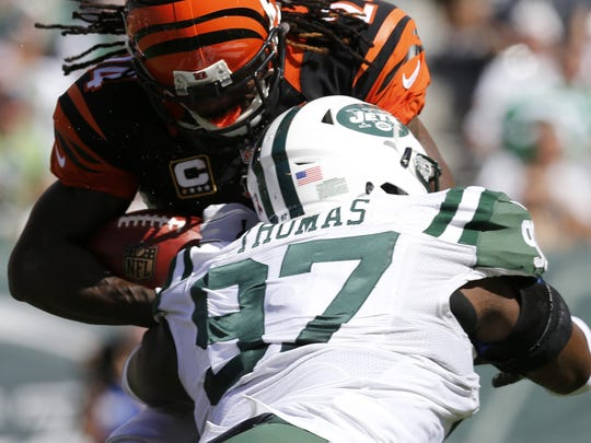 Cincinnati Bengals cornerback Adam Jones is hit on