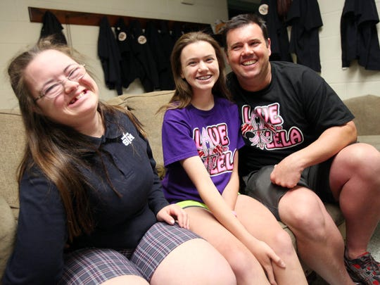 Jason Girouard is pictured with his daughters, Maddie, 12, center, and Janie, 17, at the Lafayette Fire Station #5, where he works, Tuesday, May 5, 2015, in Lafayette, La.