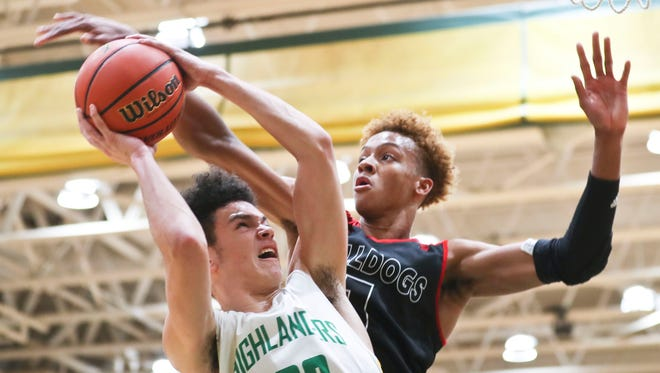 Floyd Central's Cobie Barnes goes up for two against New Albany's Romeo Langford in the first half. The Highlanders beat the Bulldogs in overtime 49-47.