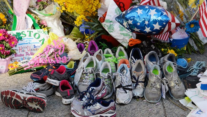 Running shoes are placed at a makeshift memorial for victims of the Boston Marathon in April 2013.