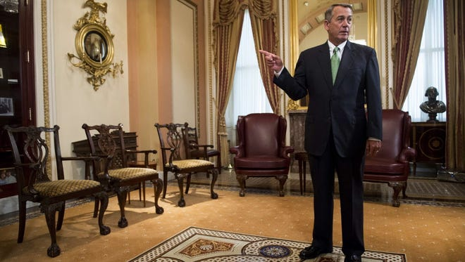 Speaker of the House John Boehner waits to greet Pope Francis in his ceremonial office at the  Capitol on Sept. 24, 2015.