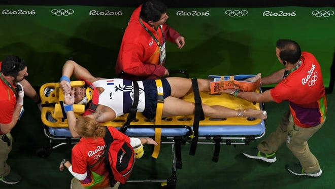 An overhead shot shows injured French gymnast Said on a stretcher after he suffered a gruesome leg injury Saturday at the 2016 Rio Olympics.