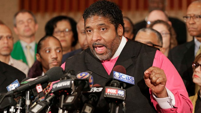 In this photo taken Thursday, Sept. 22, 2016, the Rev. William Barber speaks during a news conference after a second night of violence following the fatal police shooting of Keith Lamont Scott.