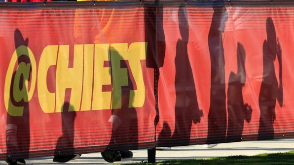 Kansas City Chiefs fans shadows are cast on a practice field fence during NFL football training camp in St. Joseph, Mo., Wednesday, Aug. 10, 2016. (AP Photo/Orlin Wagner)
