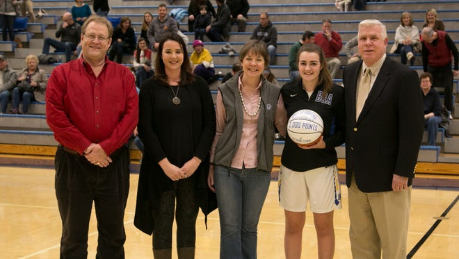 Battle Ground Academy's Allison Cowie recently became the second from the school to surpass 2,000 points. She joins Mary Blake Ray as the only two girls from the school to accomplish the feat. Pictured, from left, are father Graham Cowie, Mary Blake Ray, mother Nancy Cowie, Allison Cowie and BGA girls coach Clay Price.