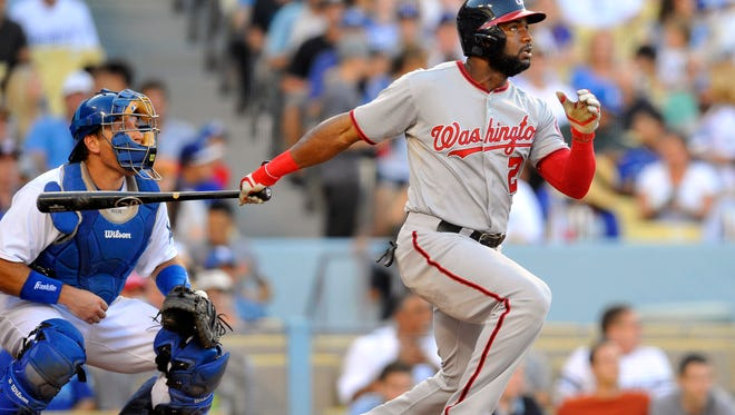 Washington Nationals center fielder Denard Span hits a solo home run in the third inning against the Los Angeles Dodgers at Dodger Stadium.