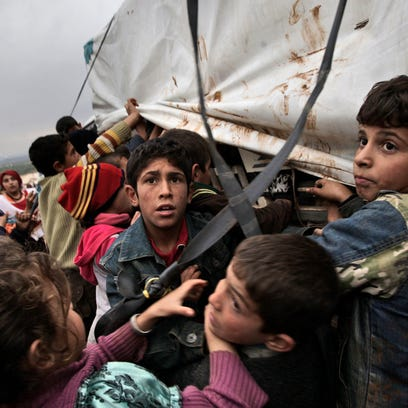 In this 2012 photo, Syrian children who fled their