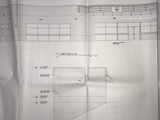 Shown are exterior plans for the brick 7-Eleven store approved for 1276 Hamburg Turnpike.