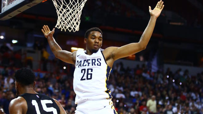 FILE -- Indiana Pacers forward Ben Moore (26) celebrates after dunking the ball against the San Antonio Spurs during an NBA Summer League game at the Thomas & Mack Center.