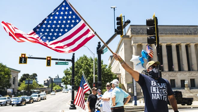 Carl Palmer of Grafton joined a crowd gathered in Lincoln Square for the America Backs the Blue rally outside the police department on Saturday. View a photo gallery on telegram.com.