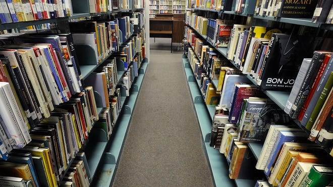 Books on shelves at the Juliette Hampton Morgan Memorial Library in Montgomery.
