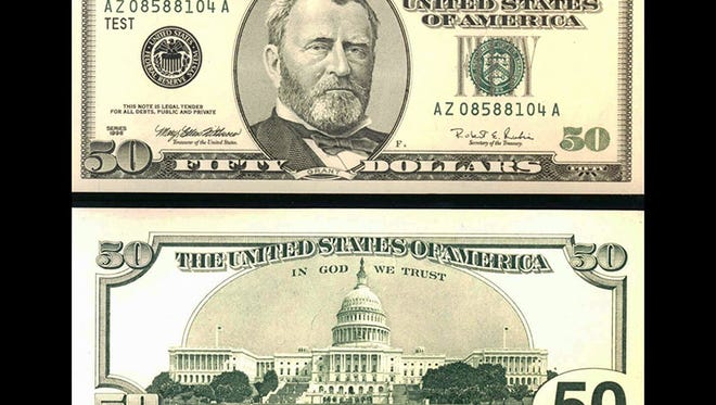 The front (top) of  the newly redesigned U.S. $50 bill, showing President Ulysses Grant, and the back (bottom), showing the U.S. Capitol building, is shown in a Treasury Department handout. The new currency includes new and modified security feature against counterfeiting.