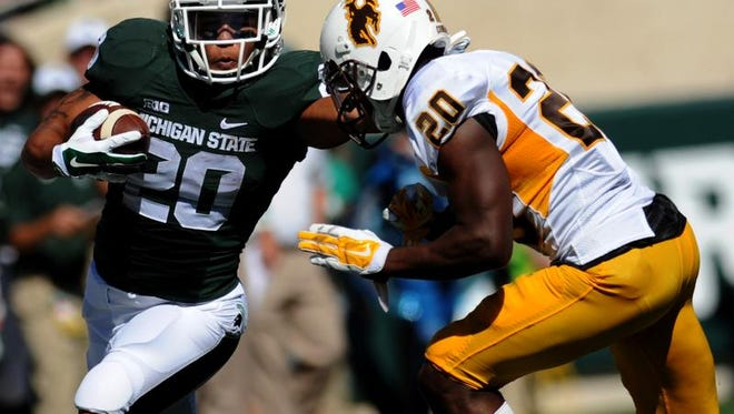 MSU's Nick Hill runs with Wyoming's Blair Burns trying to make the tackle in Saturdays game.