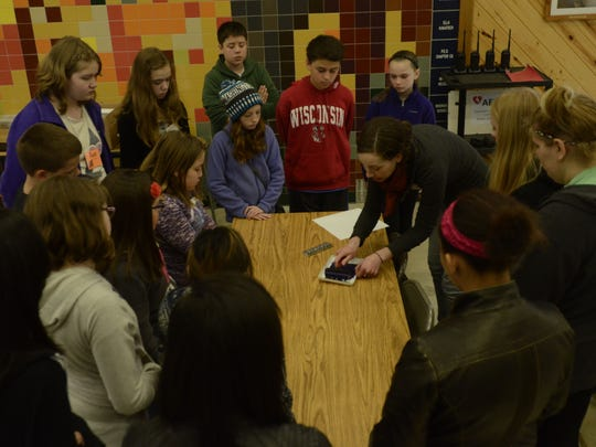 FILE - Mishicot teacher Carly Dellger teaches students about relief printing in a classroom at the Rahr Memorial School Forest.