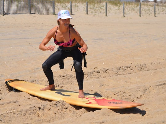Corrine Banks, a surfer and the owner of Balanced 4