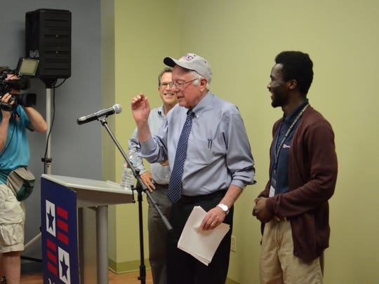 Bernie Sanders, Vermont's independent U.S. senator, accepts a New England College cap during a campaign event in Concord, N.H. on Wednesday.