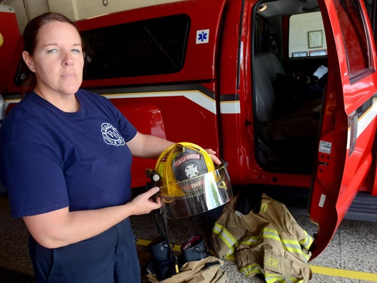 Firefighter April Fuller shows her helmet before heading out on an inspection Monday, June 15, at Central Fire Station in Port Huron.