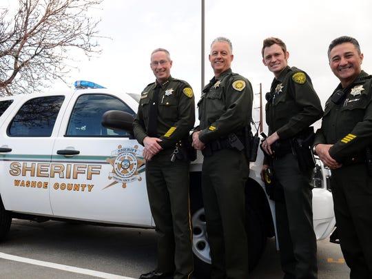 Washoe County Sheriff Chuck Allen (left) stands with three volunteer deputies in March 2015.