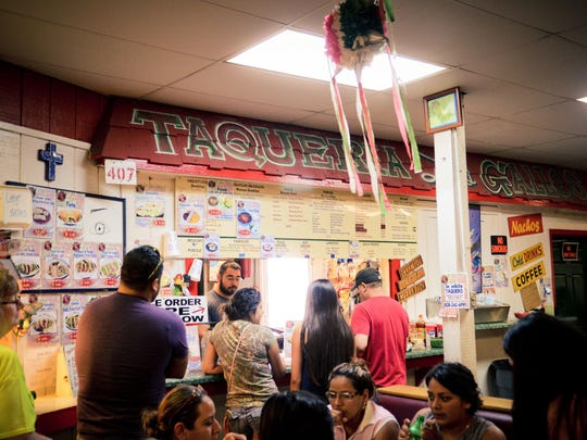 Taqueria Los Gallos draws a crowd on a Saturday morning.
