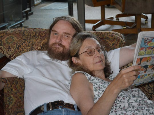Guy Lattimore shares a newspaper with his wife, Kathy, in this undated photo. Kathy Lattimore died December 31, 2013 from injuries in a car crash.