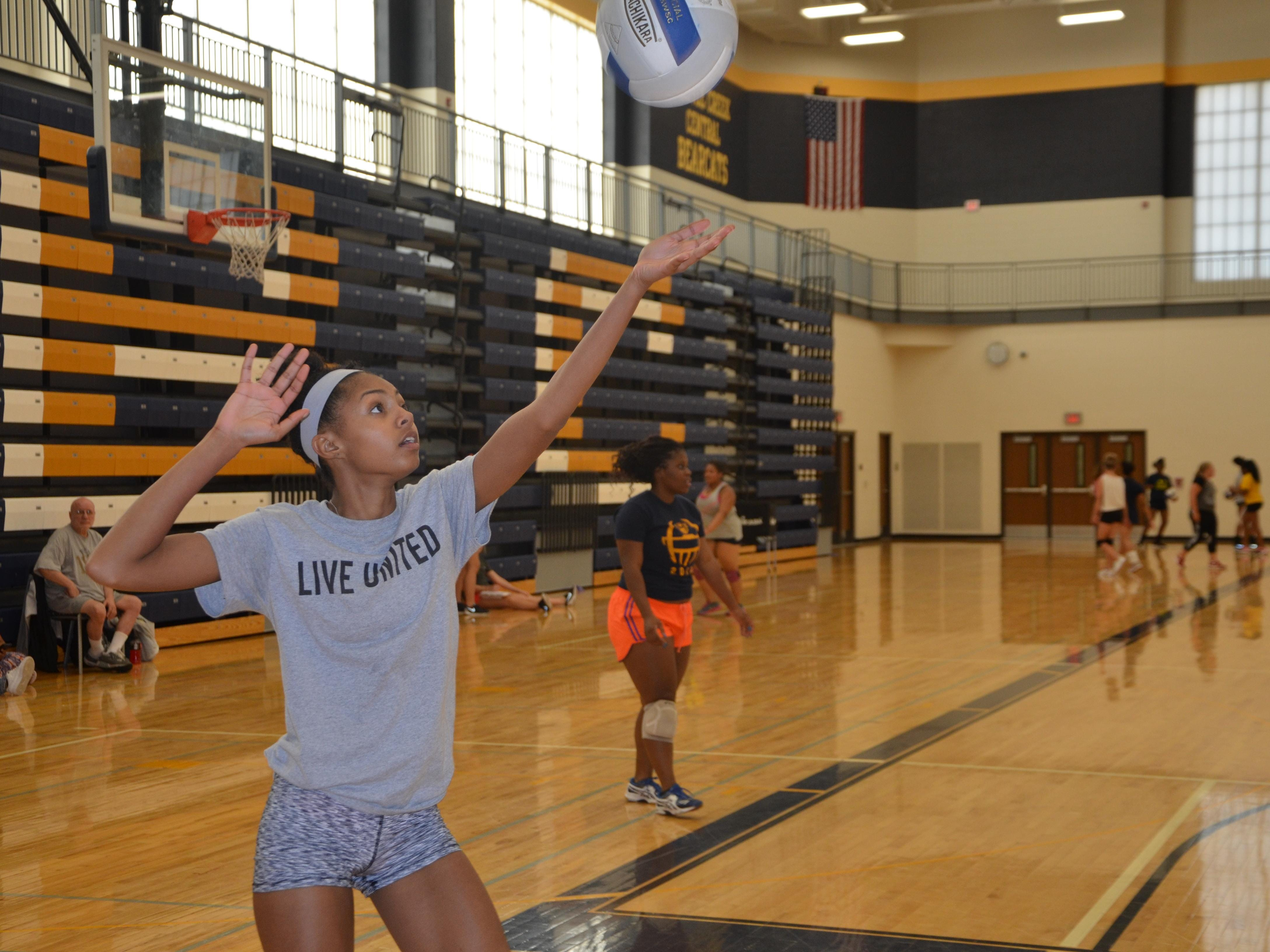 Battle Creek Central's Aaliyah Hill serves the ball for a drill during the first volleyball practice of the season on Wednesday.