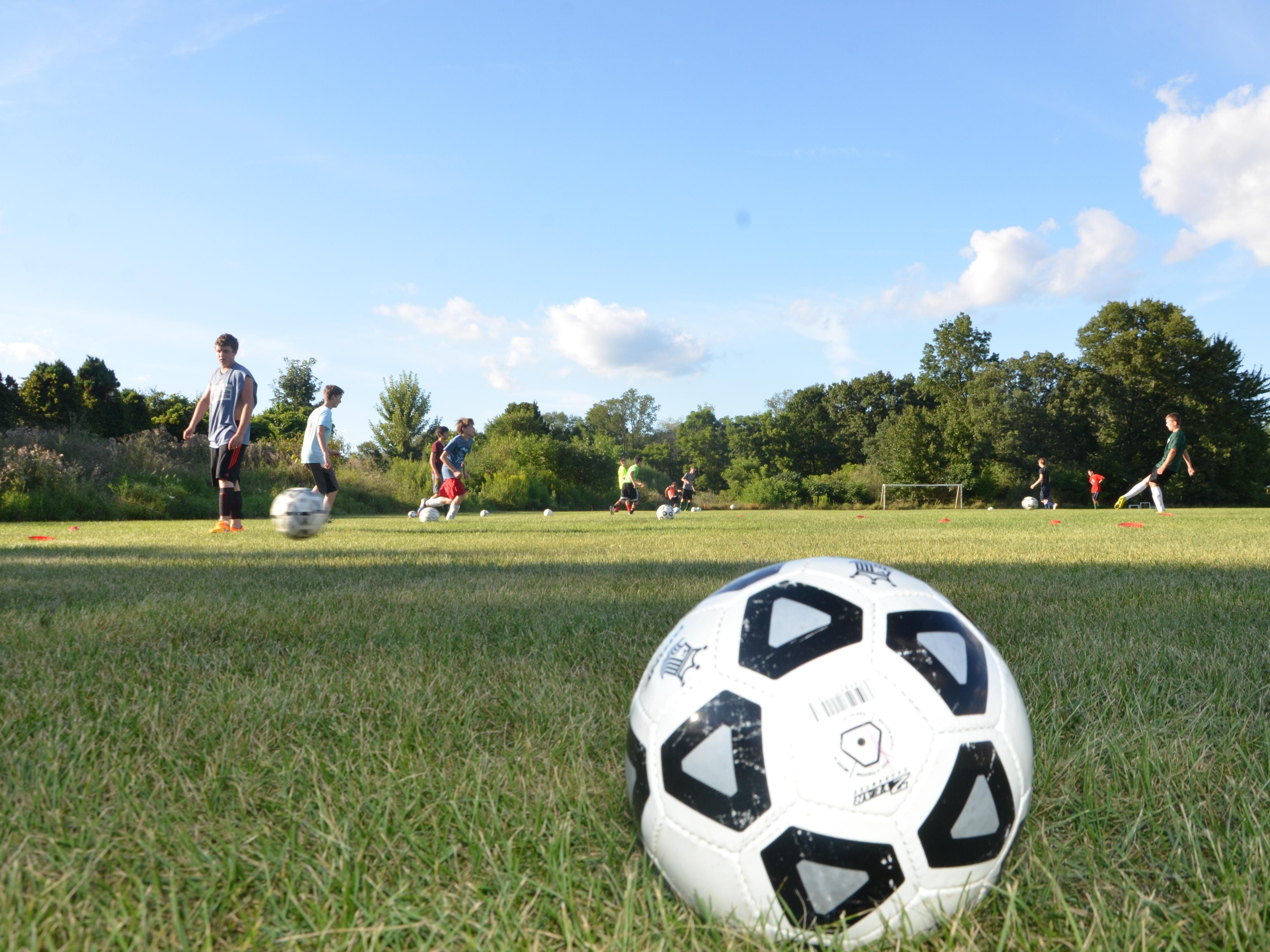 The Pennfield soccer team goes through a drill during the first practice of the season on Wednesday.