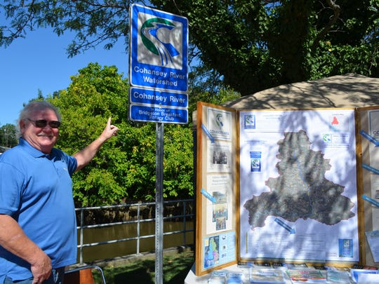 Blake Maloney, president of the Cohansey Area Watershed Association, Inc., points to a Cohnasey Watershed sign that is part of the Cohansey Watershed Signage Program. The goal is to place markers along the tributaries that feed into the Cohansey River. Signs are available for purchase and range in price from $100 to $300. For more information, visit www.cohansey.org or email info@cohansey.org Photo/Jodi Streahle