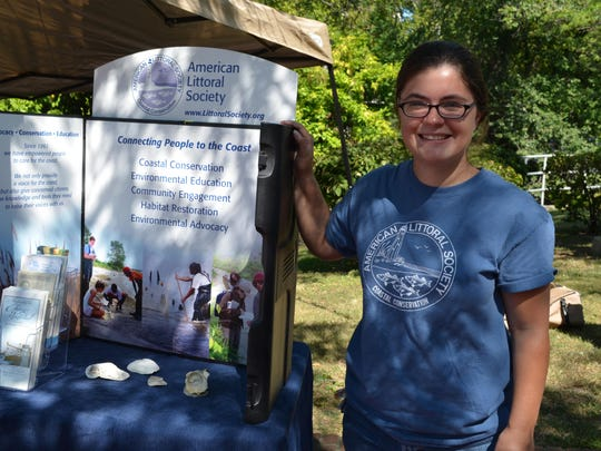 Meredith Brown, conservation coordinator at the American Littoral Society, invited Cohansey Riverfest visitors to take a pledge to conserve 20 gallons of water each day. For example, reducing shower time to five minutes could save 12,000 gallons of water per year. Photo/Jodi Streahle