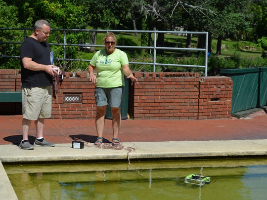 James Thomas of Bridgeton operates a remotely operated vehicle (ROV) in the fountain during Cohansey Riverfest, and Diana Burich, a Sea Grant associate, explains how the ROV functions. Photo/Jodi Streahle