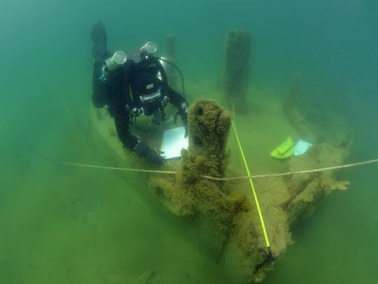 A diver takes measurements of the La Salle just off the shore of Point Beach State Forest.