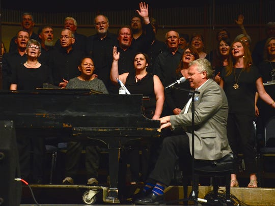 """Louisiana College President Rick Brewer joined by the Philadelphia Baptist Church Choir lead singing during the last night of """"Reboot"""" at Louisiana College."""