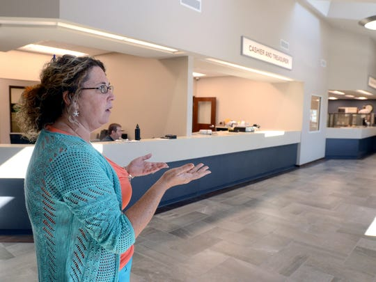 Township Supervisor Jorja Baldwin shows the new lobby area Monday, Sept 21, at the new Fort Gratiot Township hall on Keewahdin Road.