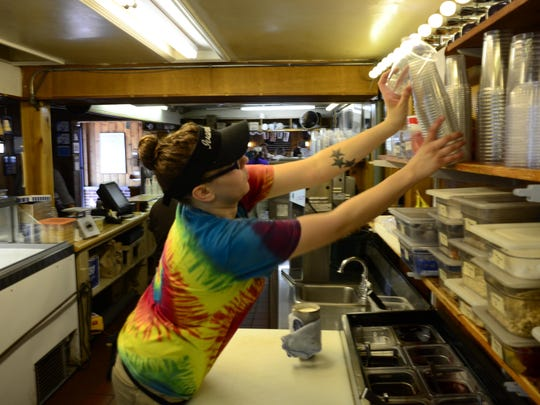 A worker at Ivanhoe's prepares a sundae for a customer on Sept. 16, 2015 in Upland, Indiana.
