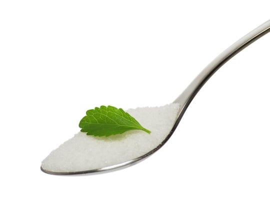 teaspoon with sugar and stevia leaf