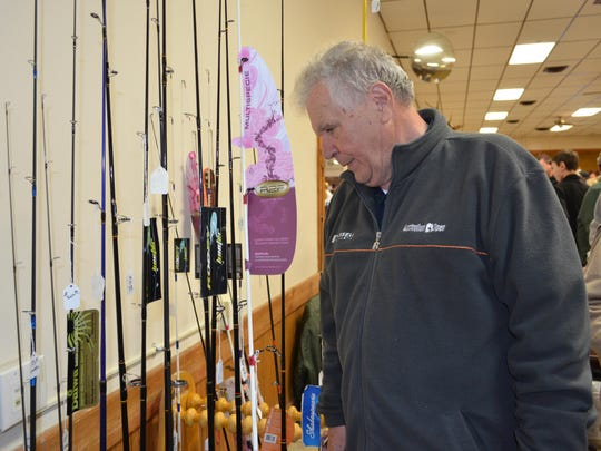 John Lombardo of Williamstown checks out some fishing rods.