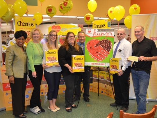 The ShopRite Partners in Caring Cheerios Box Contest raised $1.3 million dollars to help fight hunger in communities where ShopRite stores operate across six states. Pictured during the Cheerios box unveiling at the ShopRite of Hammonton are Orien Reed, ShopRite spokesperson; Colette Krause, food sourcing coordinator at the Community Food Bank of New Jersey Southern Branch; ShopRite associate Stephanie Bozella of Waterford; ShopRite assistant managers Melissa Meier, Bob Newton and Ryan Smith; and Ed Muller, director of the St. Vincent de Paul food pantry.