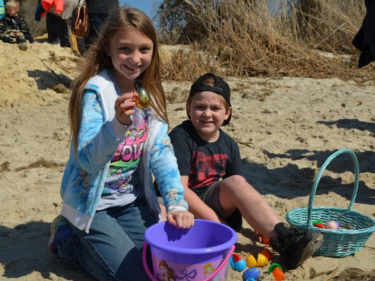 Autumn Whildon, 10, of Dorchester and Aidan Grippo, 9, of Oceanview check out their eggs on the beach.