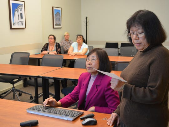 Jianrong Wang and Kerry Chang-FitzGibbon discuss the changing role of a technical services librarian during the Day of Scholarship at Stockton University.