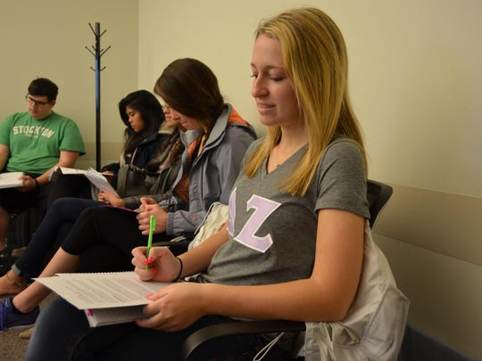 Carleigh Cooper, a freshman at Stockton University, takes notes during one of the presentations at the 16th annual Day of Scholarship.