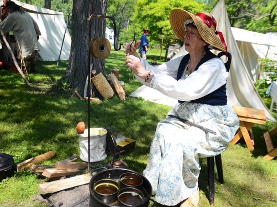 Micki Smith, 79, of Clinton Township, acted as a candle maker during Sanilac County Historical Village and Museum's Voyageurs, Settlers and Natives weekend on Sunday.