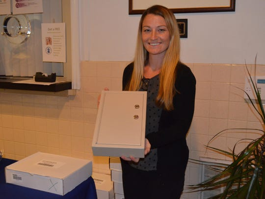 Kelly Gallagher of Join Together Atlantic County distributed medicine lock boxes provided by Atlantic Prevention Resources during the drug and alcohol abuse summit held Aug. 29 at Buena Vista Township Hall.